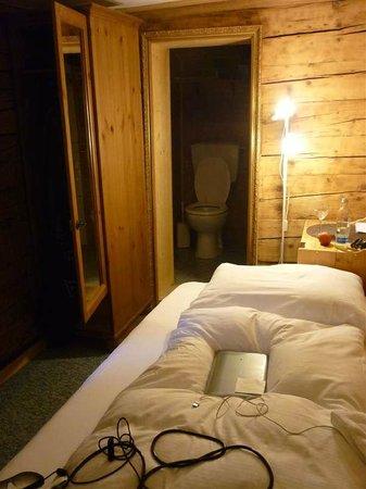 The Rustico Hotel: bathroom and bedroom