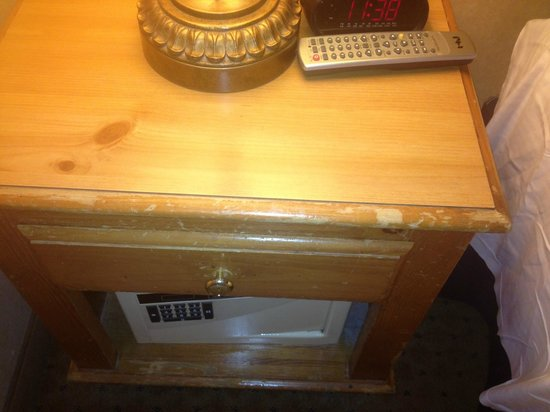 Texas Station Gambling Hall and Hotel: Old / Worn-out / Scratched bedside table.