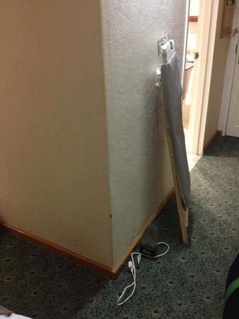 Protea Hotel Midrand : The wooden ironing board, note the old walls