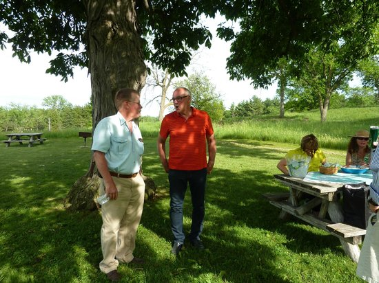 Country Driving Tours of Vermont: A break and a snack with tour guide, George Landis (in red)