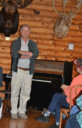 Raquette Lake Navigation Co: Pianist, Bob Miline, sharing period music at Pine Knot