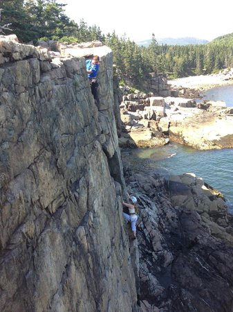 Acadia Mountain Guides Climbing School : My wife rappeling down Otter Cliff as Avi belays from the edge.