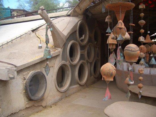 Cosanti Foundation: Windows into studio with ceramic bells outside.