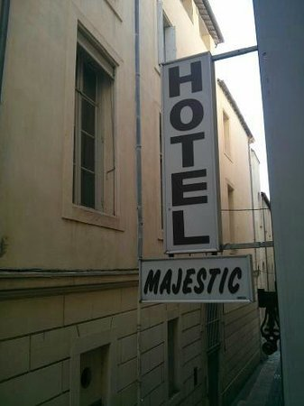 Hotel Majestic: The hotel sign & alley/street you enter on
