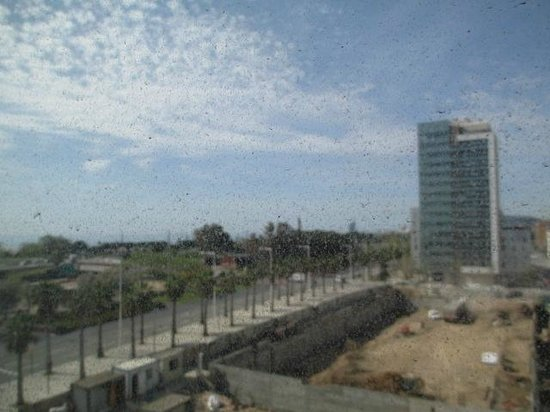 Eurohotel Diagonal Port: View through rather sandy window over building site