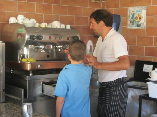 Hotel Museum: Breakfast Chef shows our grandson how to make cappuccino.