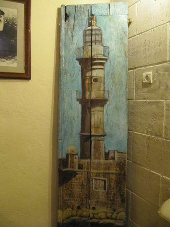 Porto del Colombo Hotel: amazing painting of the lighthouse in the breakfast room