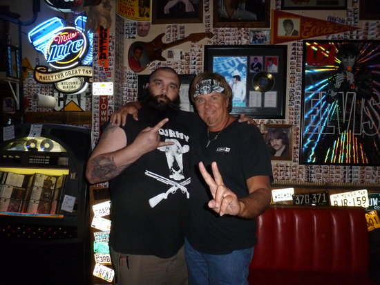 Hogs N Heifers Saloon: Guitarist Dowlin Mayfield and the bouncer at Hors and Heifers