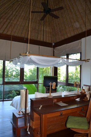 Six Senses Samui: Bedroom by day - see the wall of windows!