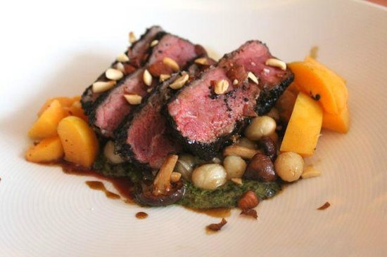 Blackbird : Dry-aged striploin with roasted chanterelles, pocha beans, apricot, and seaweed pesto