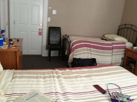 The Inn at Crystal Cove: twin bed by the door, double bed in front of picture #204