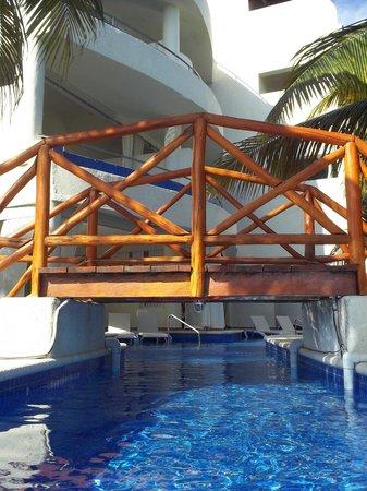 El Dorado Maroma By Karisma Walkway Over Swim Out Area To Pool