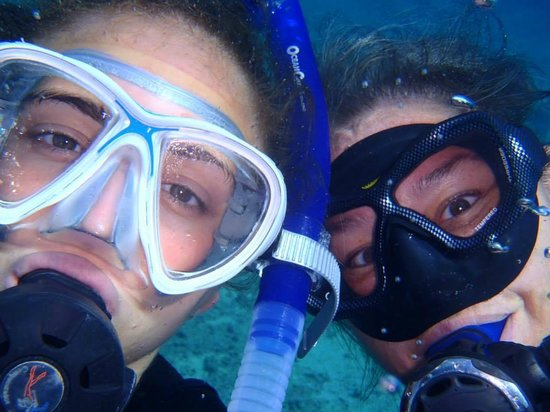 Blue Angel Scuba School: Ariel and Kari on their shore dive so thrilled to have found the frogfish!