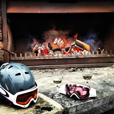 Treble Cone: Wine by the outdoor fireplace