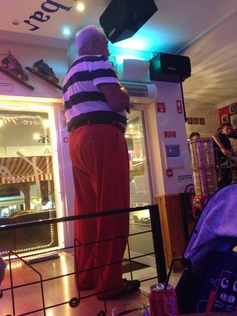 Absolbar: Love the red trousers the karaoke king wears
