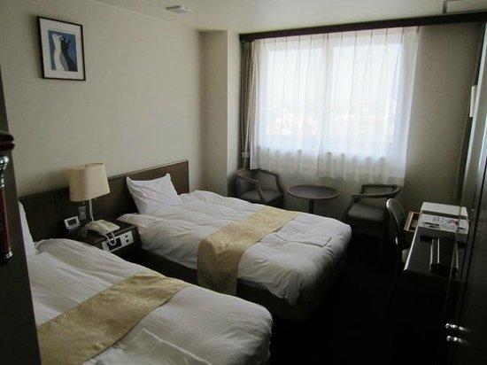 Hotel New Palace: ベットメイクは、とても素敵で枕もピッタリ満足でした