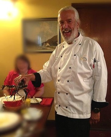 Red Bank Restaurant: Chef Terry McCoy with a smile, introduces guests to a lobster