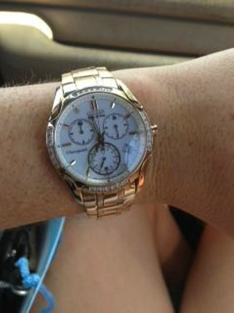 Jewel House : rose gold watch with a white face and diamonds