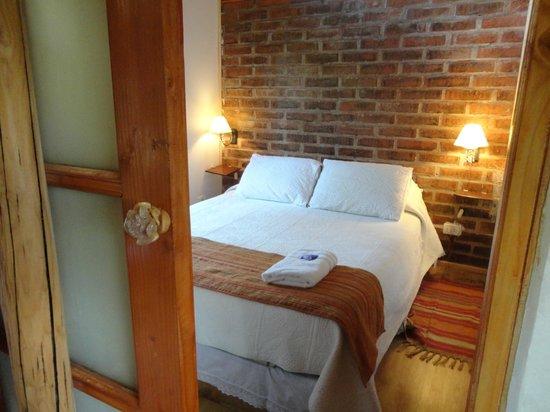 Cabañas Huarranchi: Confortables dormitorios matrimoniales
