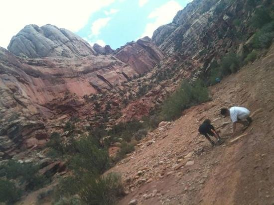 Grand Wash Trail: boys playing with red sand/clay/mud. so great...until they got into the rental car