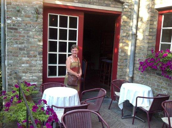 Azalea Hotel: Terri outside on patio, doors lead to lounge