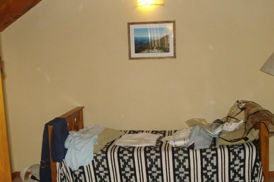 Cabañas Posada de Montaña: Sector de la cama individual