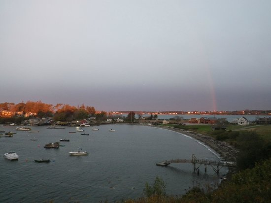 Log Cabin: An Island Inn: Rainbow (on the right) over the bay filled with lobster pots/boats!