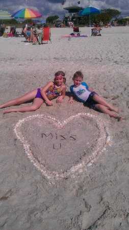 Nokomis Beach: For a text to their big sister, who couldn't come.  Nice shells though!