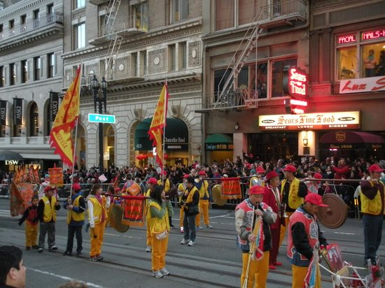 The Chinese New Year's parade cruises by Sears Fine Foods