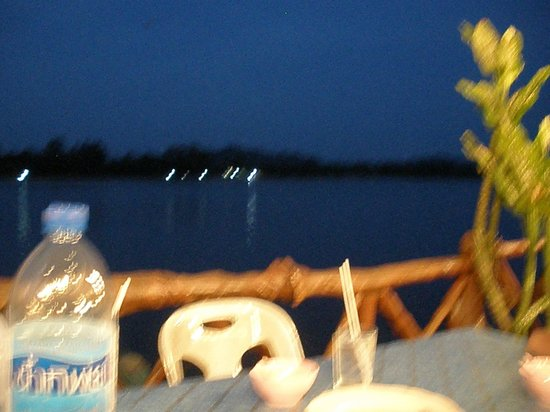 Lanta Seafood: An evening view from the restaurant to the next island.
