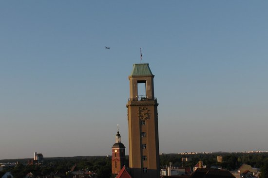 Ibis Berlin Spandau: A PLANE FLYING OVER THE SPANDAU TOWN HALL TOWER HAVING TAKEN OFF FROM TEGEL AIRPORT