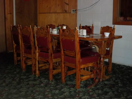 Paradise Cafe : Dining room has tables with chairs or booths.