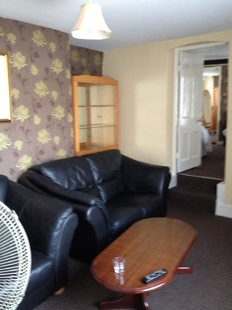 The Old Vicarage: room with old random furniture