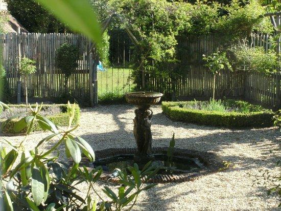 Bothy in Grayshott: View of Italian water feature garden
