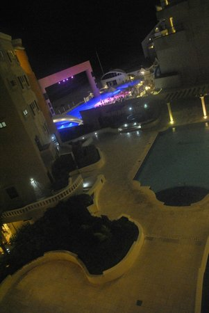 NYX Hotel Cancun: view from room 214 (NYX inner pool, ME by Melia pool area and sea)