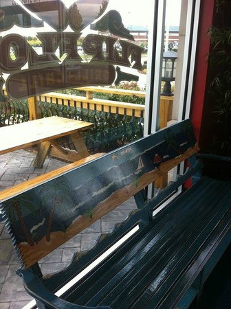 Flip Flop's Chill and Grill: Outdoor seating seen through window