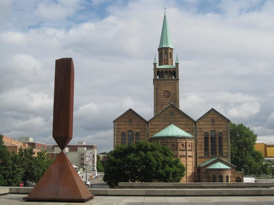 New National Gallery (Neue Nationalgalerie): Terrace, with sculpture (1963) by Barnett Newman, and St-Matthaus-Kirche
