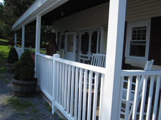 Heart 'n Hand: tables and chairs on the shady front porch