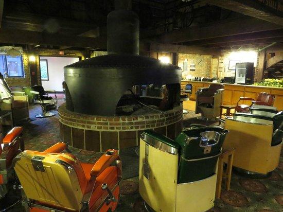Don Q Inn: Lobby area - barbershop chairs and locomotive engine fireplace