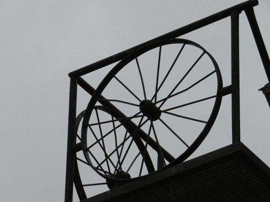 Don Q Inn: Iron wheel used for art