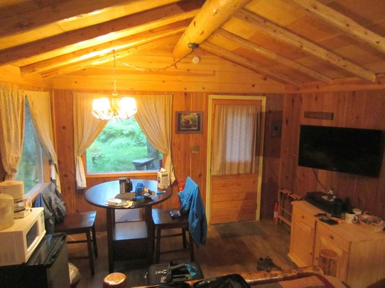 Alaska Creekside Cabins: Spruce cabin has nice dining table, small fridge, and some shelves to store items