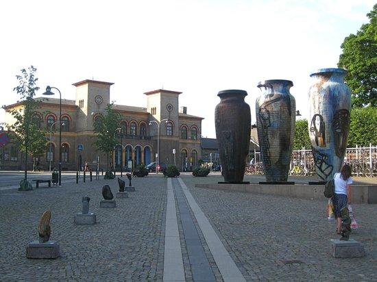 """Roskildekrukkerne: The """"Roskilde Jars,"""" with Roskilde's railway station behind (1847; oldest in Denmark)"""