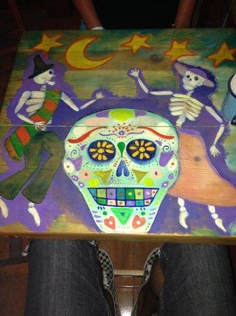 "La Terraza: Art work on the table we sat at (im assuming representing ""Dia de Muertos"""