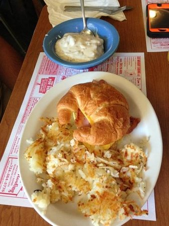 The Hay Loft Restaurant : Breakfast sandwich and 1/2 order of biscuits and gravy.