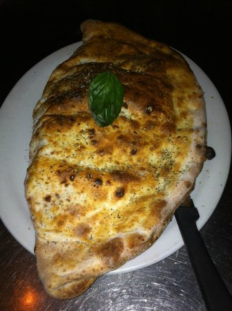 Ferro Bar & Cafe: Now that's Calzone! Folded over pizza pie.