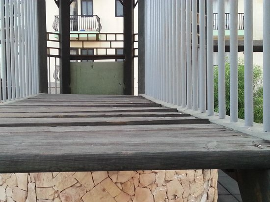 The San Anton Hotel : rotting wood on walk way on play equipment