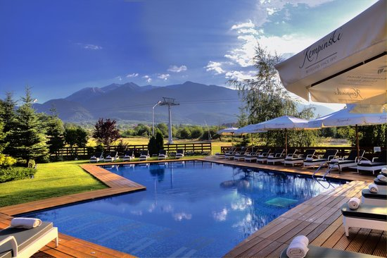 Kempinski Hotel Grand Arena : Outdoor swimming pool with a Mountain view