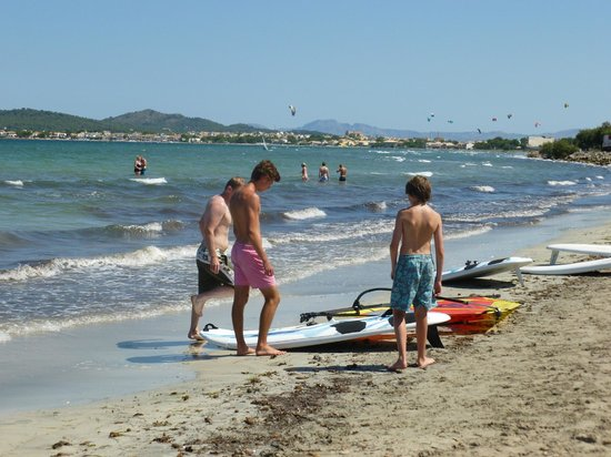 Beach Near Hotel For Windsurfing Club Has Beds And Parasols