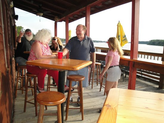 Andersen's Lodge : Waters Edge Pub - patrons enjoying our deck over the water.