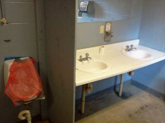 Whispering Pines Campsites: the nearest mens bathroom